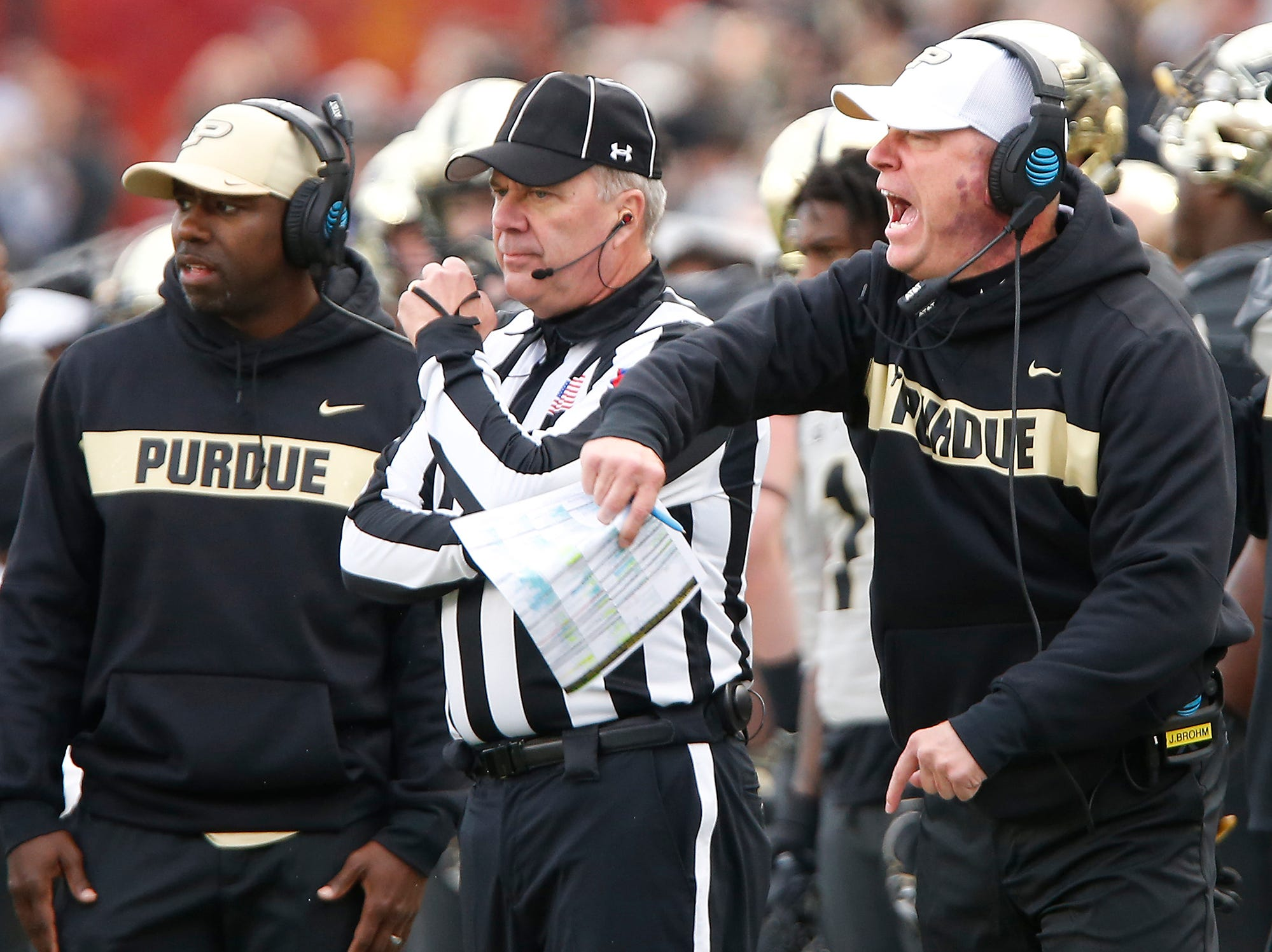 Purdue head coach Jeff Brohm shouts at the officials after the Boilermakers were whistled for a penalty during a punt to Iowa late in the first half Saturday, November 3, 2018, at Ross-Ade Stadium. Purdue defeated Iowa 38-36.