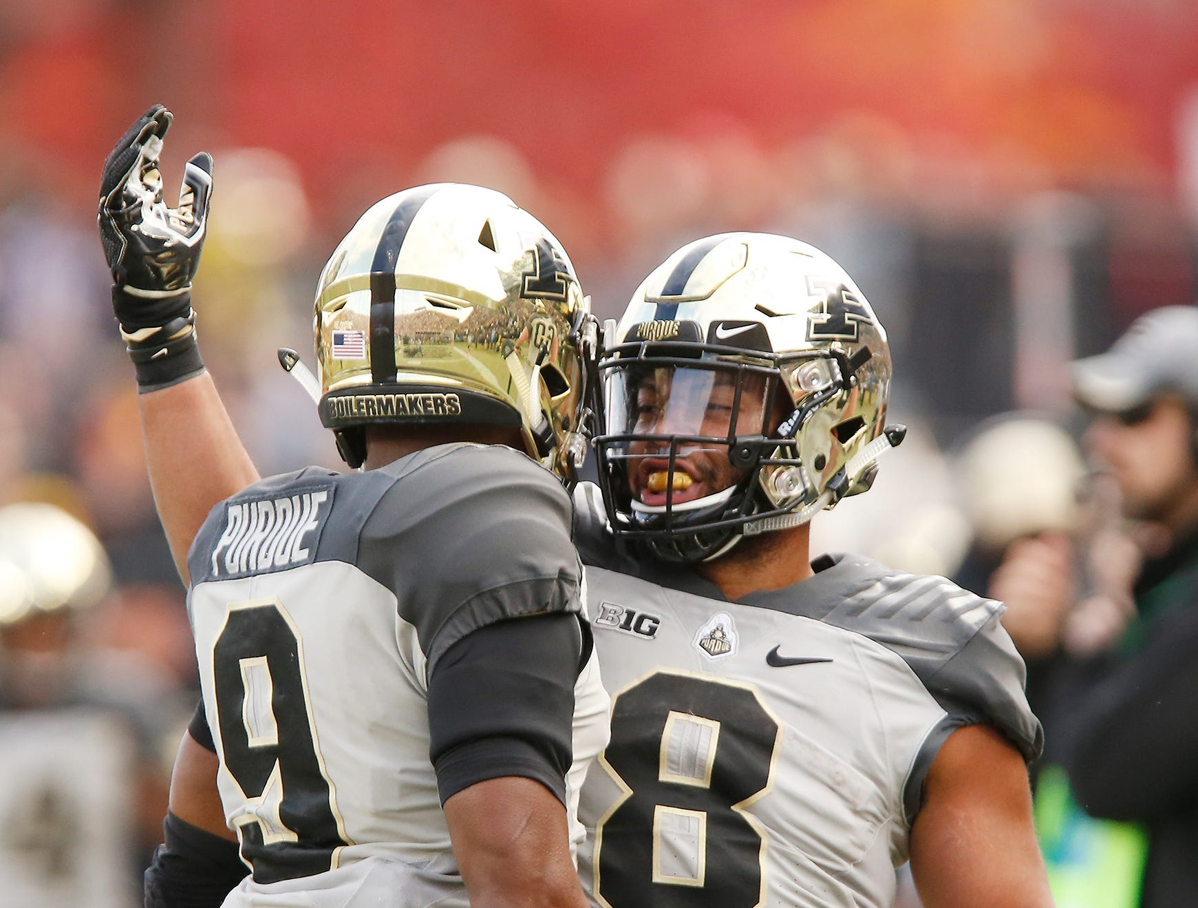 Markell Jones of Purdue celebrates with Terry Wright after Wright's touchdown reception at 6:27 in the second quarter against Iowa Saturday, November 3, 2018, at Ross-Ade Stadium. Purdue defeated Iowa 38-36.