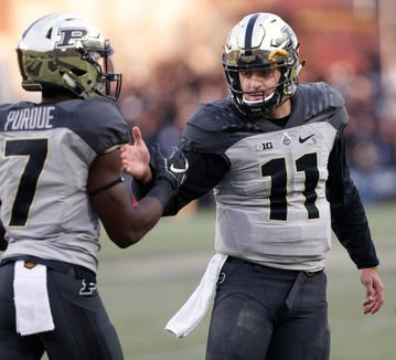Purdue quarterback David Blough shakes hands with Isaac Zico after throwing a touchdown pass to Terry Wright at 2:26 in the third quarter against Iowa Saturday, November 3, 2018, at Ross-Ade Stadium. Purdue defeated Iowa 38-36.