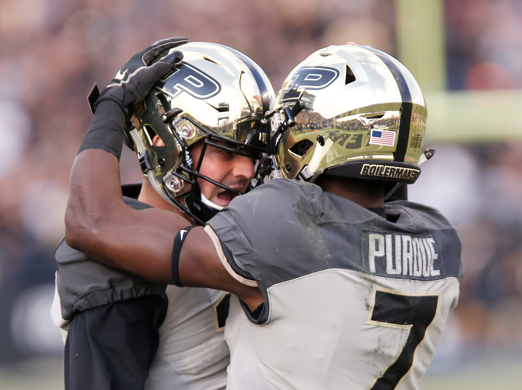 Purdue quarterback David Blough congratulates Isaac Zico after the pair connected for a touchdown at 11:56 in the first quarter against Iowa Saturday, November 3, 2018, at Ross-Ade Stadium. Purdue defeated Iowa 38-36.