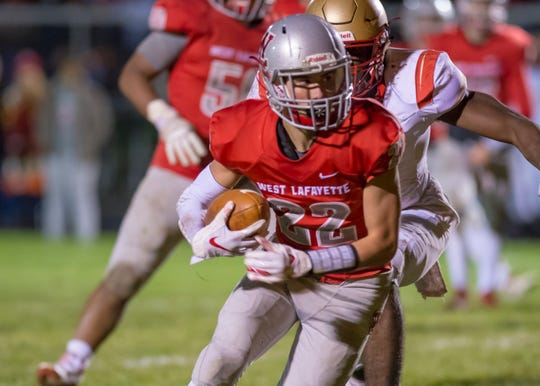 R.J. Erb gets some needed yards after the catch in the sectional championship game between West Lafayette and Andrean.
