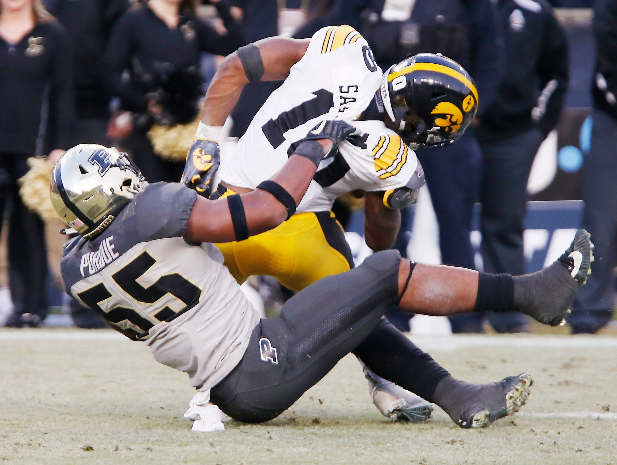 Derrick Barnes of Purdue brings down Mekhi Sargent of Iowa in the second half Saturday, November 3, 2018, at Ross-Ade Stadium. Purdue defeated Iowa 38-36.
