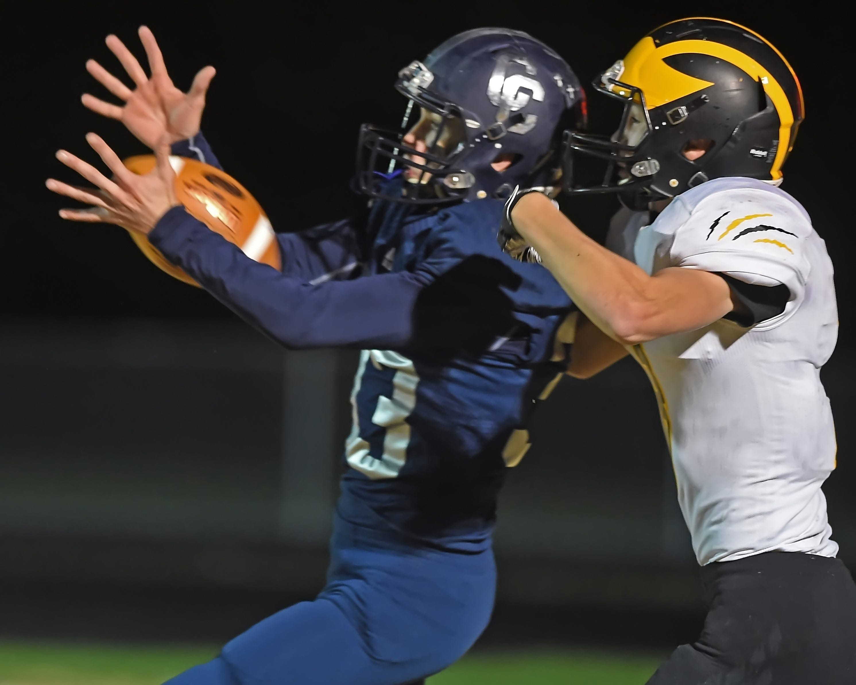 Central Catholic senior Mason Gray cuts in front of Pioneer's Calahan Kindley for an interception at the 2.