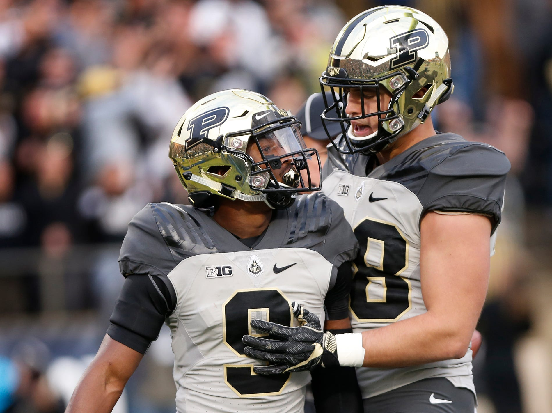 Terry Wright, left, of Purdue celebrates with teammate Cole Herdman after his touchdown reception at 2:26 in the third quarter against Iowa Saturday, November 3, 2018, at Ross-Ade Stadium. Purdue defeated Iowa 38-36.