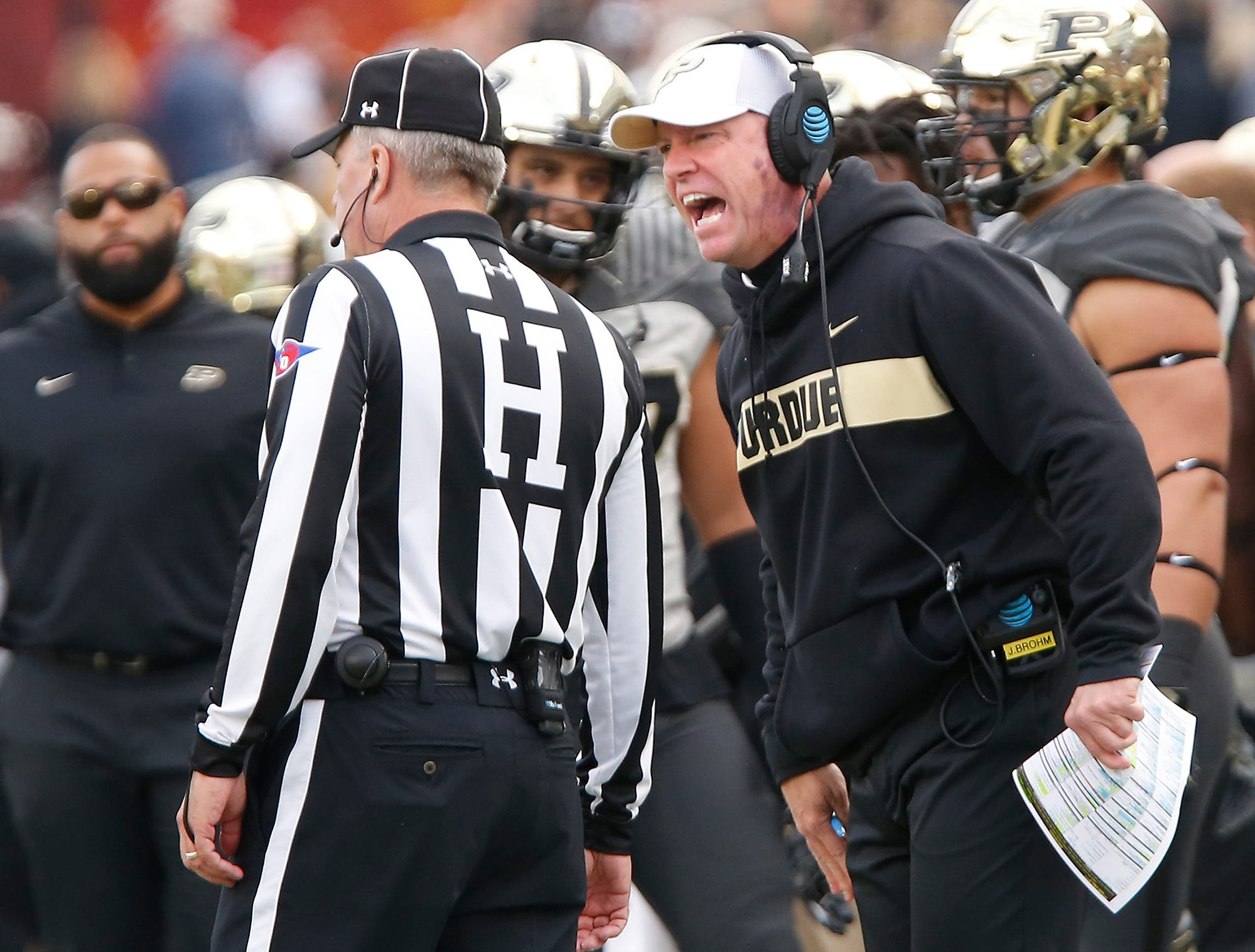 Purdue head coach Jeff Brohm gives an official an earful after the Boilermakers were whistled for a penalty during a punt to Iowa late in the first half Saturday, November 3, 2018, at Ross-Ade Stadium. Purdue defeated Iowa 38-36.