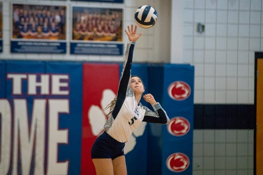 STM's Emily Bourque serves the ball at the start of the rally as the Cougars play in a playoff game against Academy of Our Lady at St. Thomas More on November 3, 2018.