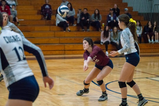 STM's Lizzy Low bumps the ball up  as the Cougars play in a playoff game against Academy of Our Lady at St. Thomas More on November 3, 2018.