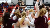 Charyl Stockwell's volleyball team celebrates the first district championship by any team in school history.