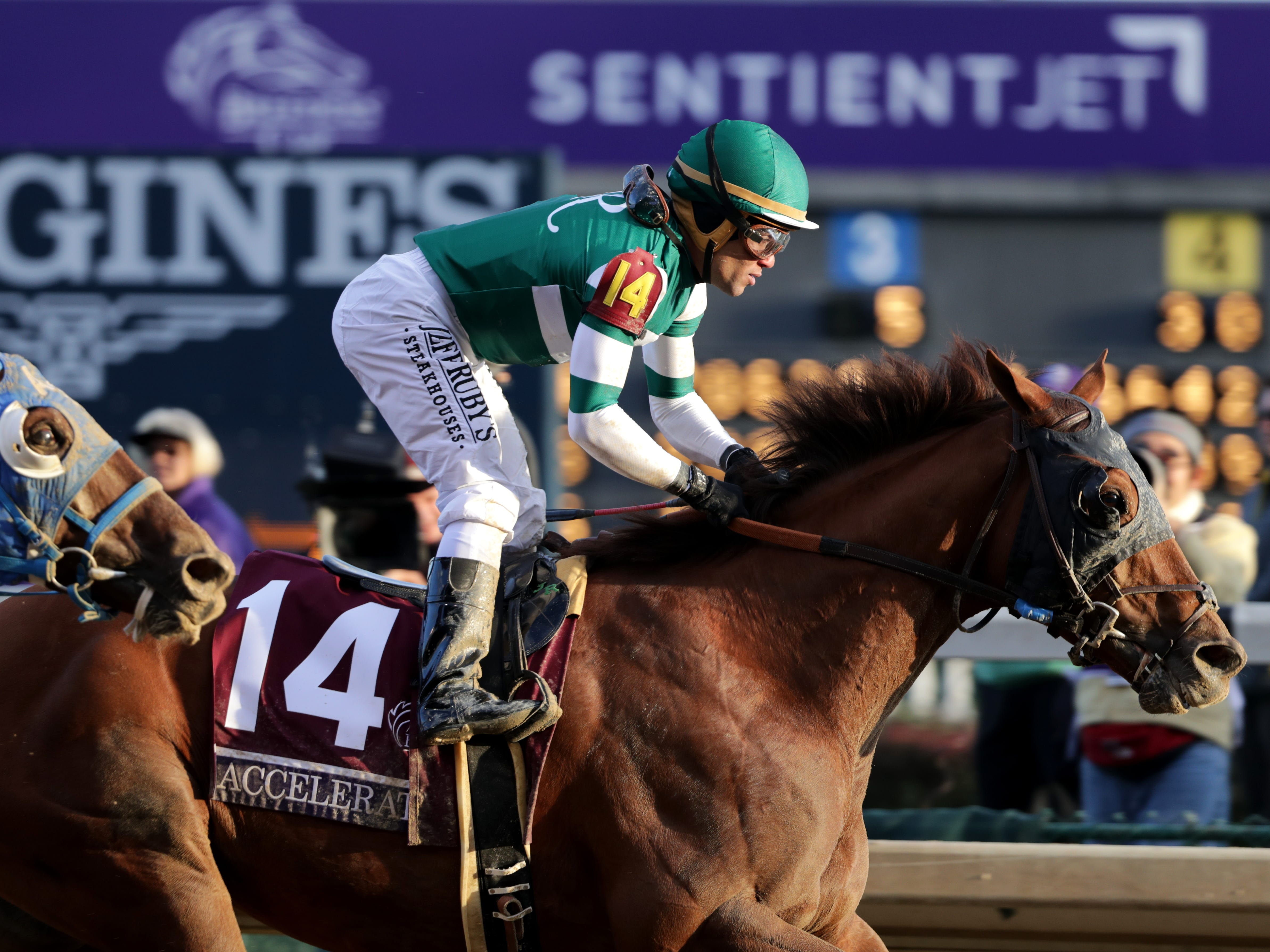 Accelerate, with jockey Joel Rosario aboard, wins the Breeders' Cup Classic at Churchill Downs. Nov. 3, 2018.