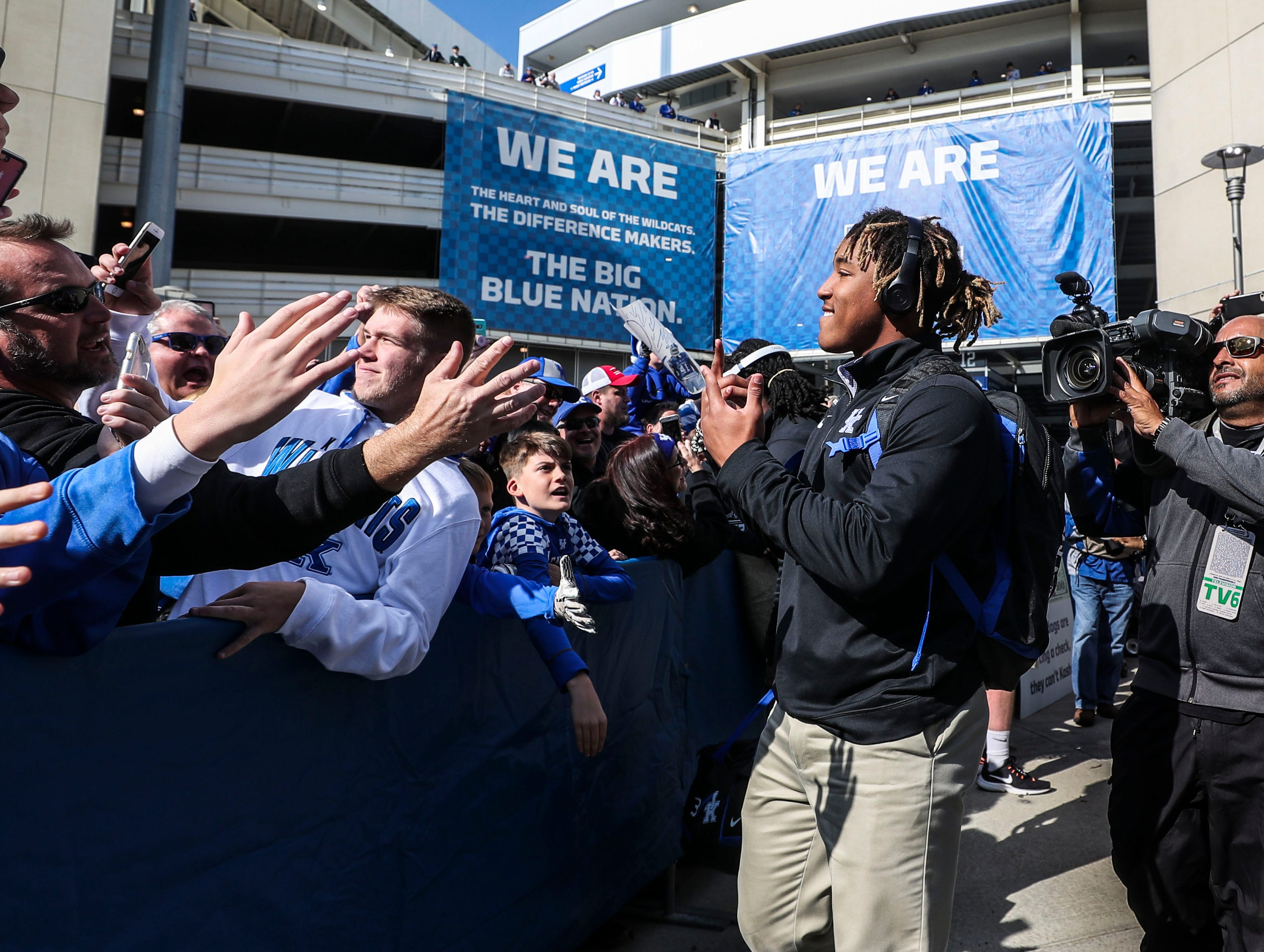 Kentucky running back Benny Snell greets fans at the Cat Walk before the Kentucky-Georgia game Saturday. Nov. 3, 2018
