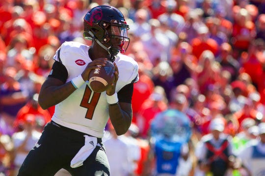Louisville Cardinals quarterback Jawon Pass (4) looks to pass the ball during the first half against the Clemson Tigers at Clemson Memorial Stadium in Clemson, South Carolina, on Saturday, Nov. 3, 2018.