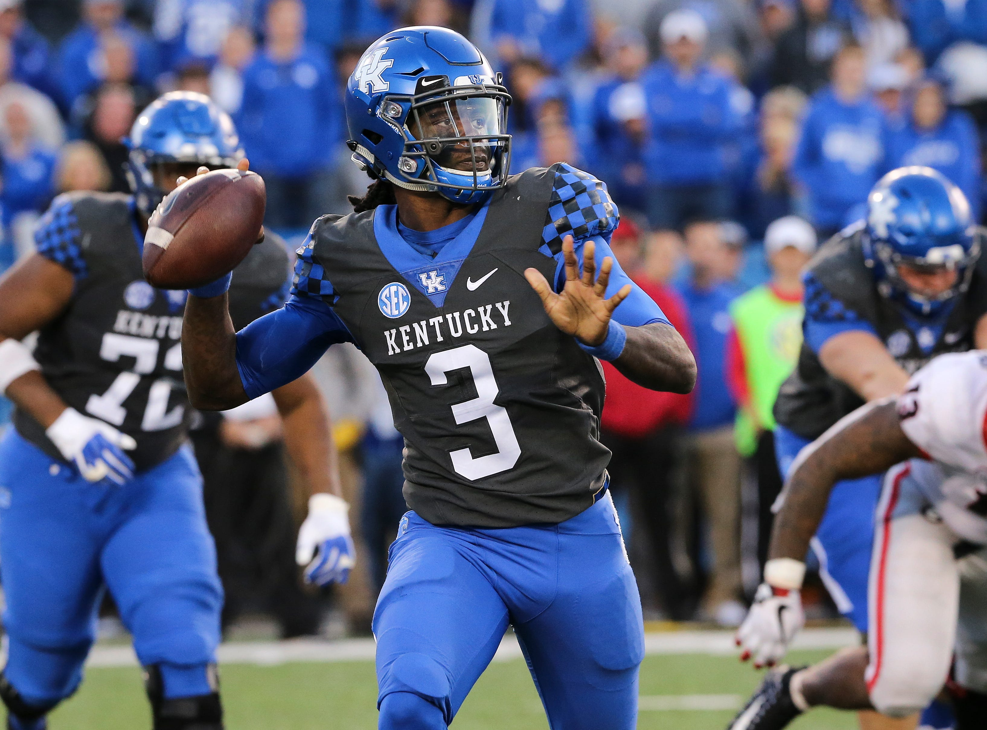 UK QB Terry Wilson (3) looked to pass against Georgia during their game at Kroger Field in Lexington.  