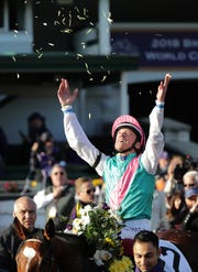 Frankie Dettori celebrates after Enable's Breeders' Cup Turf win.