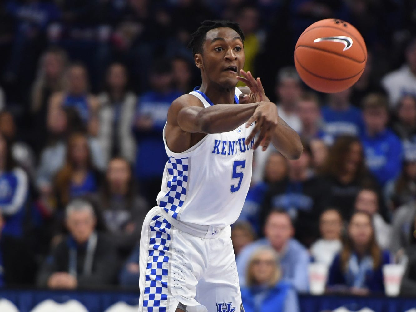 Immanuel Quickly passes the ball during the University of Kentucky  basketball game against Indiana University of Pennsylvania at Rupp Arena on Friday, Nov. 2, 2018.