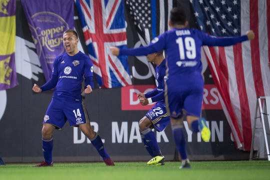 Ilija Ilic (14) celebrates his goal in Saturday's win.