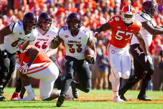 Louisville's Colin Wilson rushes with the ball during the first half of Saturday's loss to Clemson.