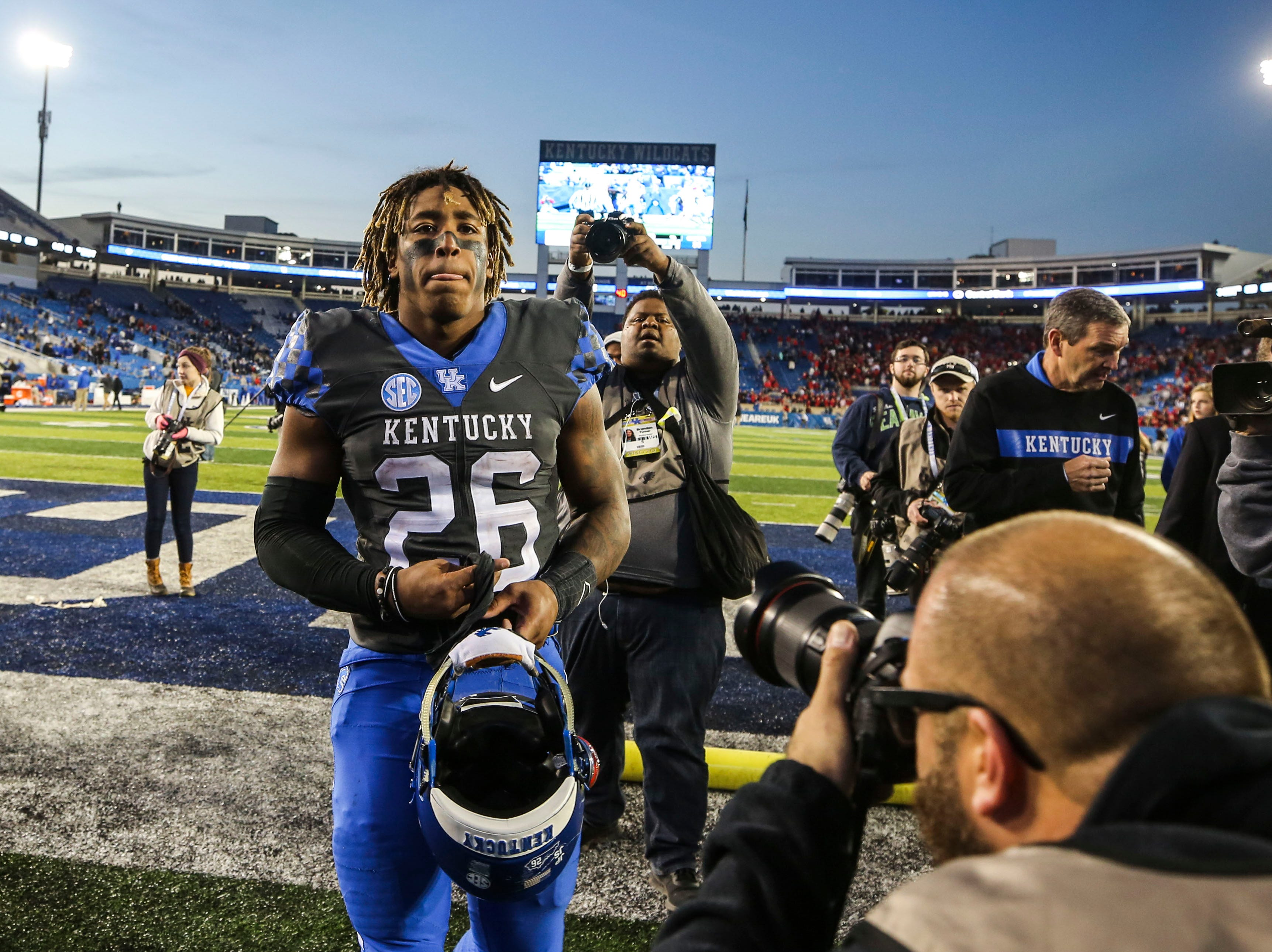 Kentucky's Benny Snell walks towards the lorcker room after a disappointing loss to Georgia Saturday night, ending the Wildcats' hopes for an SEC East title. Nov. 3, 2018