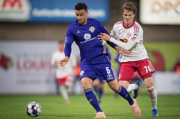 Louisville City FC defender Paco Craig (5) plays against New York Red Bulls II forward Tom Barlow (74) during the United Soccer League Eastern Conference Final match played at Slugger Field on Nov. 2, 2018.