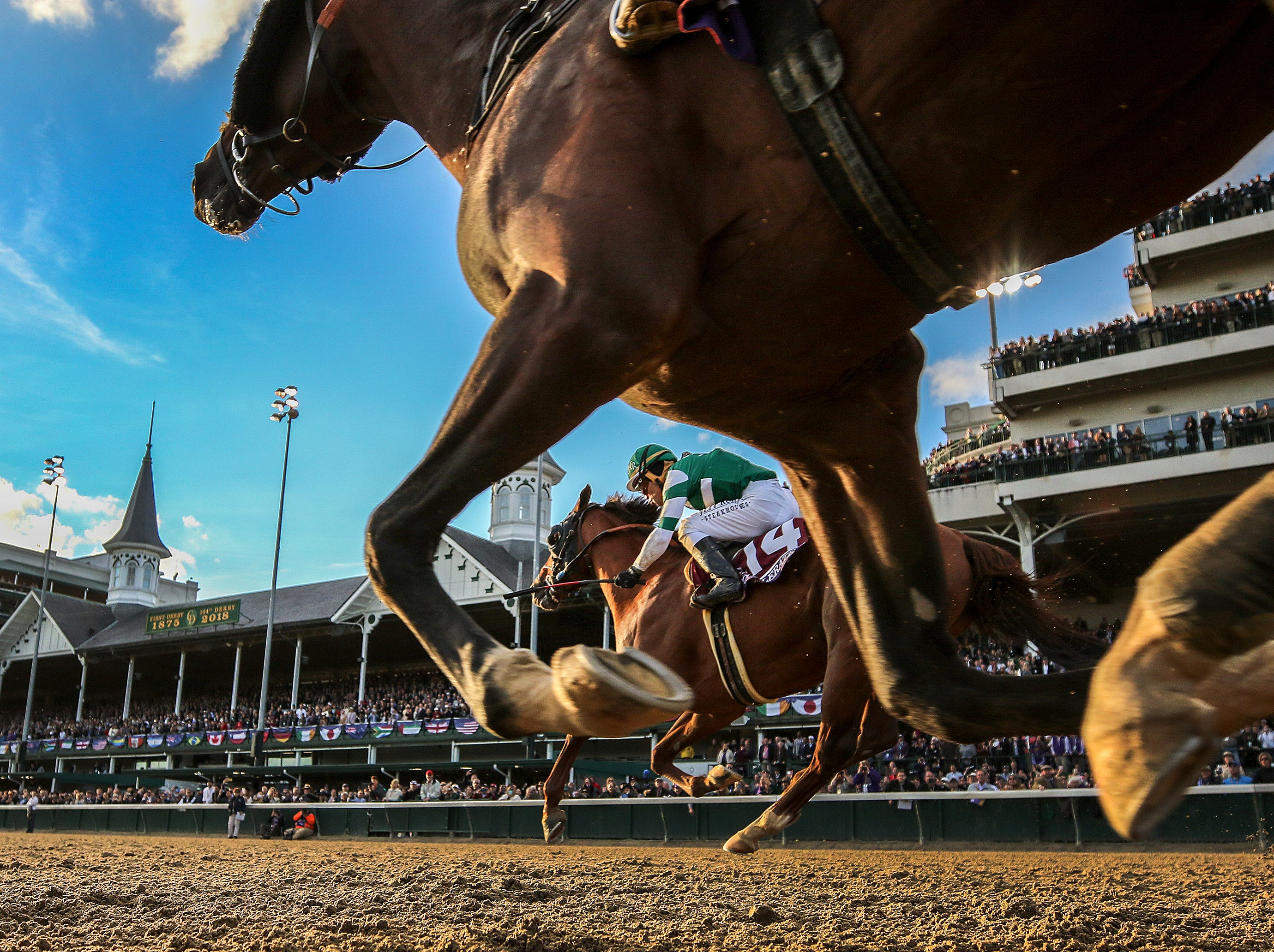 Accelerate, background, with Joel Rosario up, wins the Breeders' Cup Classic at Churchill Downs on Saturday.