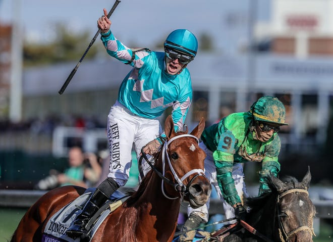 Monomoy Girl with Florent Geroux aboard, center, wins the Longines Breeders' Cup Distaff.November 3, 2018