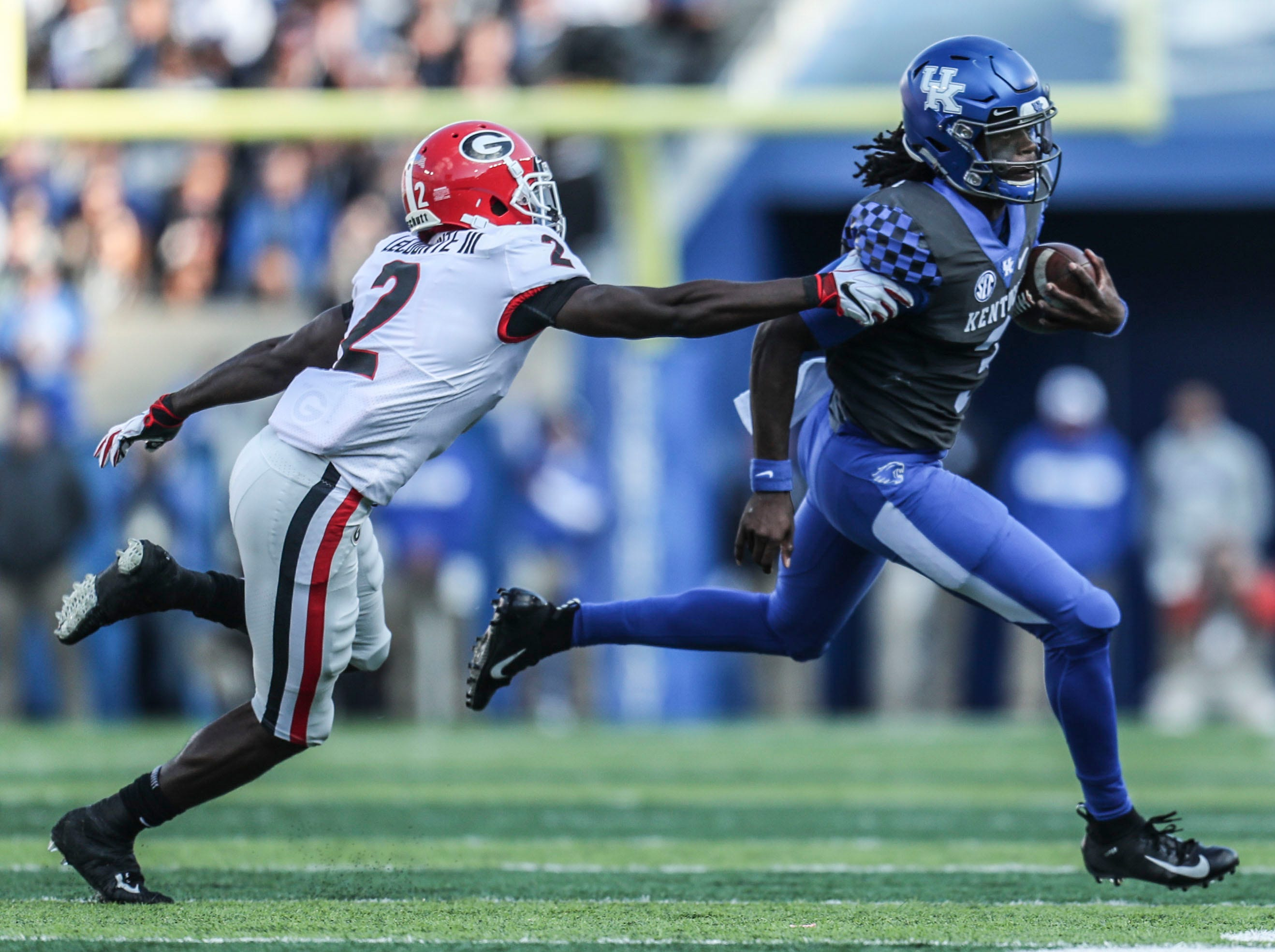 Kentucky's Terry Wilson tried to evade Goergia's Richard LeCounte in the first half.  Saturday. Nov. 3, 2018