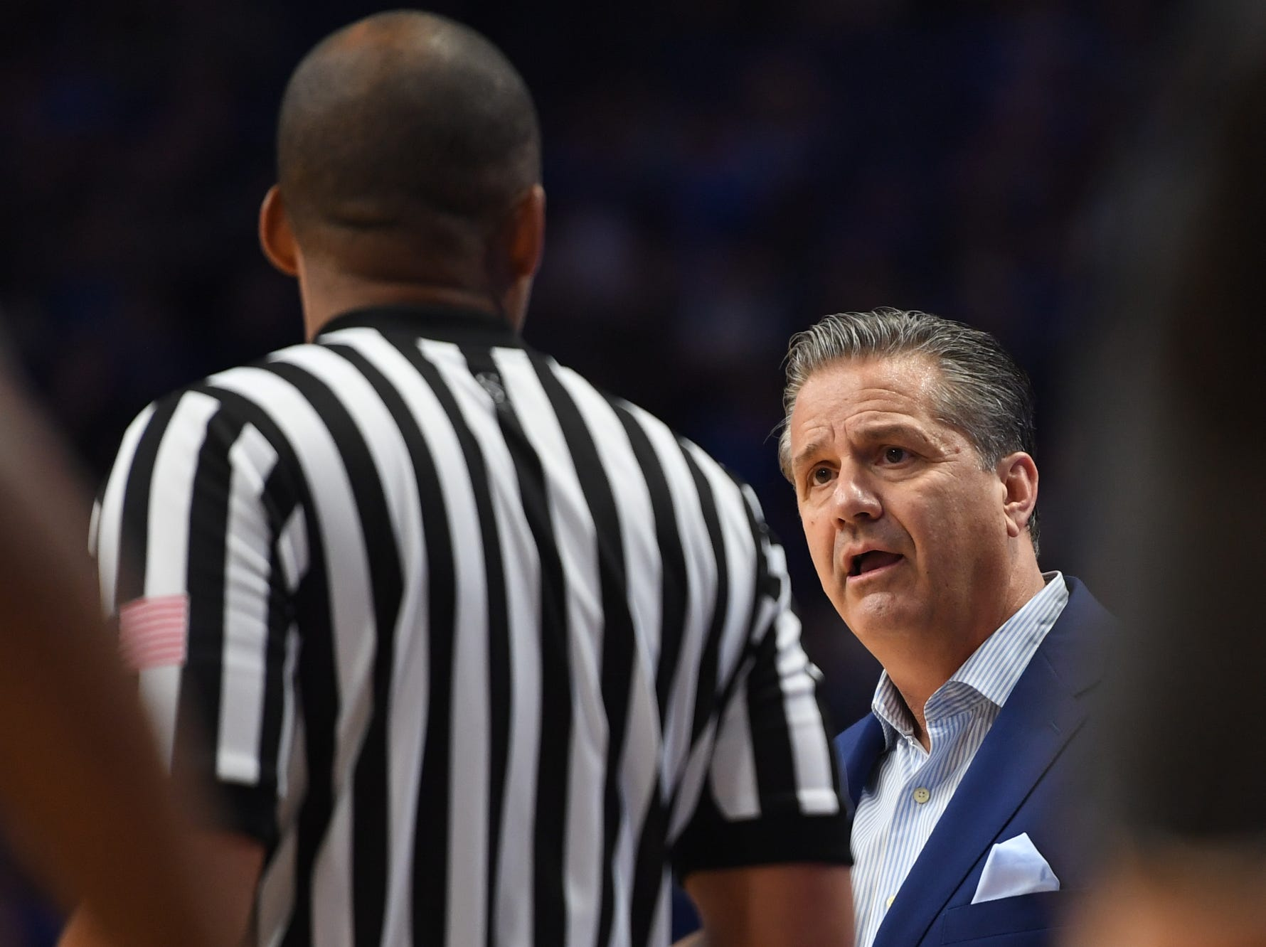 UK head coach John Calipari talks with an official during the University of Kentucky basketball game against Indiana University of Pennsylvania at Rupp Arena on Friday, Nov. 2, 2018.