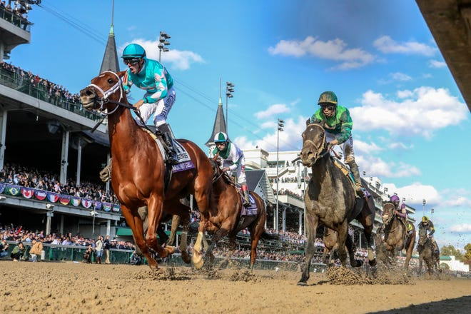 Monomoy Girl with Florent Geroux aboard, center, wins the Longines Breeders' Cup Distaff.