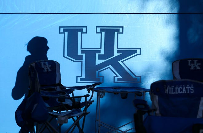 A fan is silhouetted against a UK tent before the Kentucky-Georgia game Saturday morning. Nov. 3, 2018