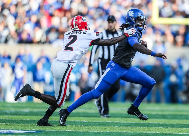 Kentucky's Terry Wilson tries to evade Georgia's Richard LeCounte in the first half Saturday.