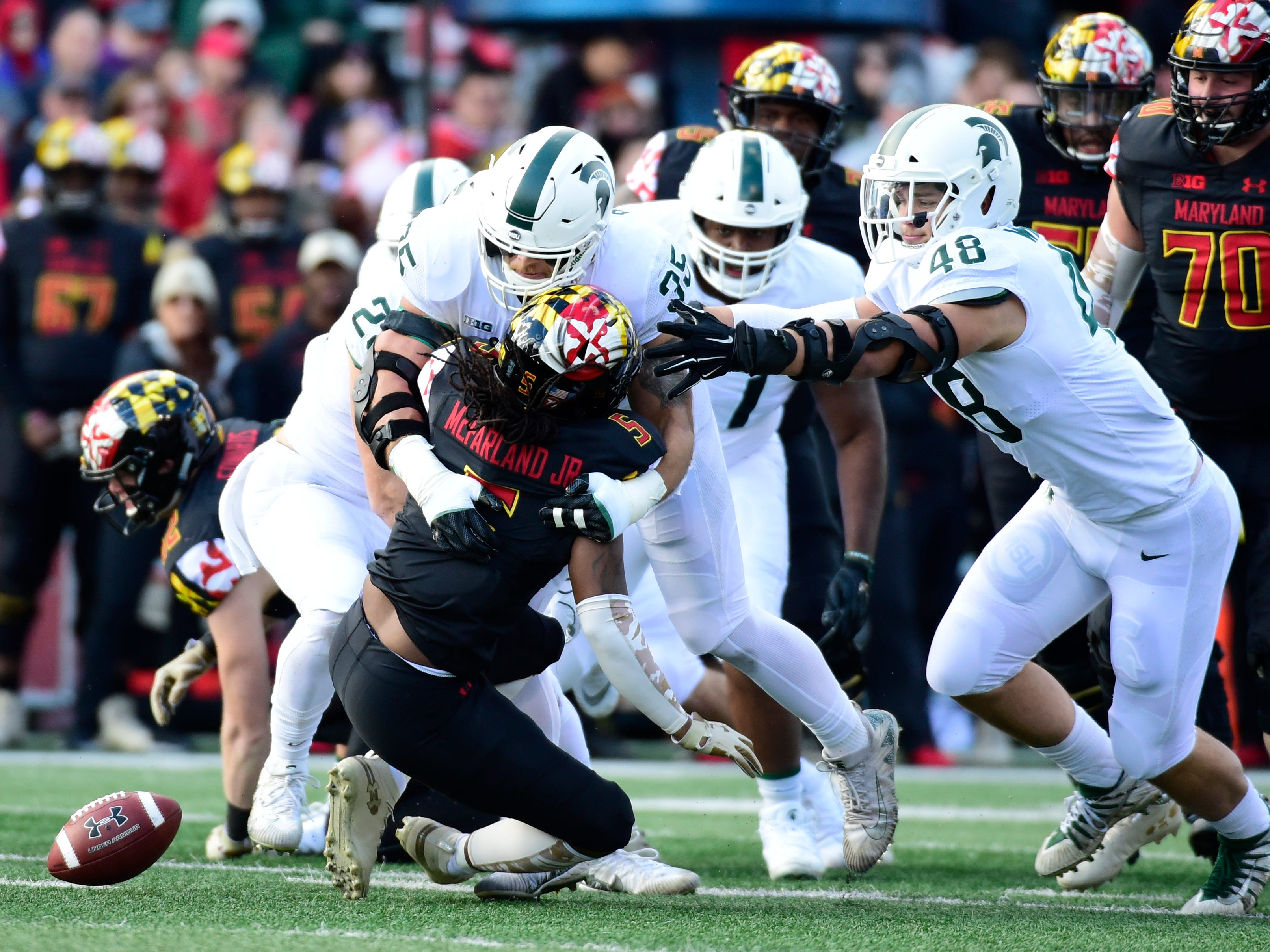 Michigan State Spartans linebacker Joe Bachie (35) hits Maryland Terrapins running back Anthony McFarland (5) behind the line of scrimmage causing a fumble during the first quarter at Capital One Field at Maryland Stadium.