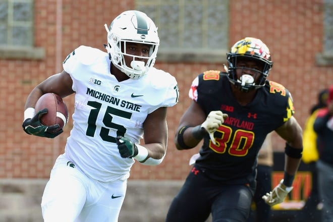 Michigan State Spartans running back La'Darius Jefferson (15) rushes as Maryland Terrapins linebacker Durell Nchami (30) chases during the second quarter at Capital One Field at Maryland Stadium.