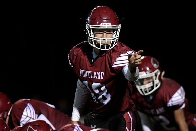 Portland's quarterback Owen Russell communicates with a receiver during the fourth quarter on Friday, Nov. 2, 2018, at Portland High School.