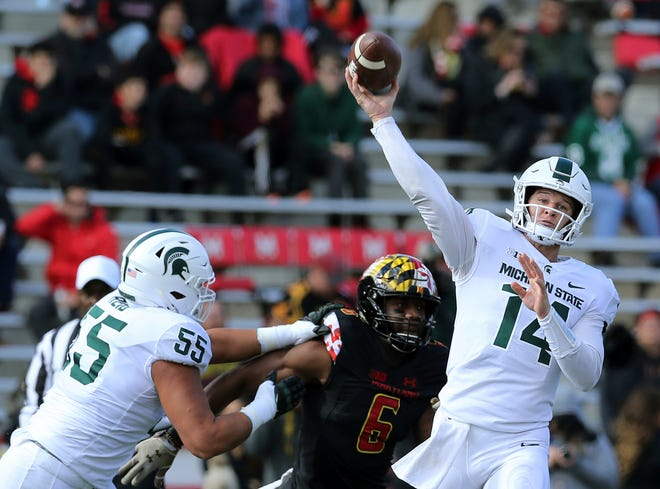 Brian Lewerke threw 20 times Saturday, completing 11 passes for 87 yards. He also ran eight times for 54 yards.
