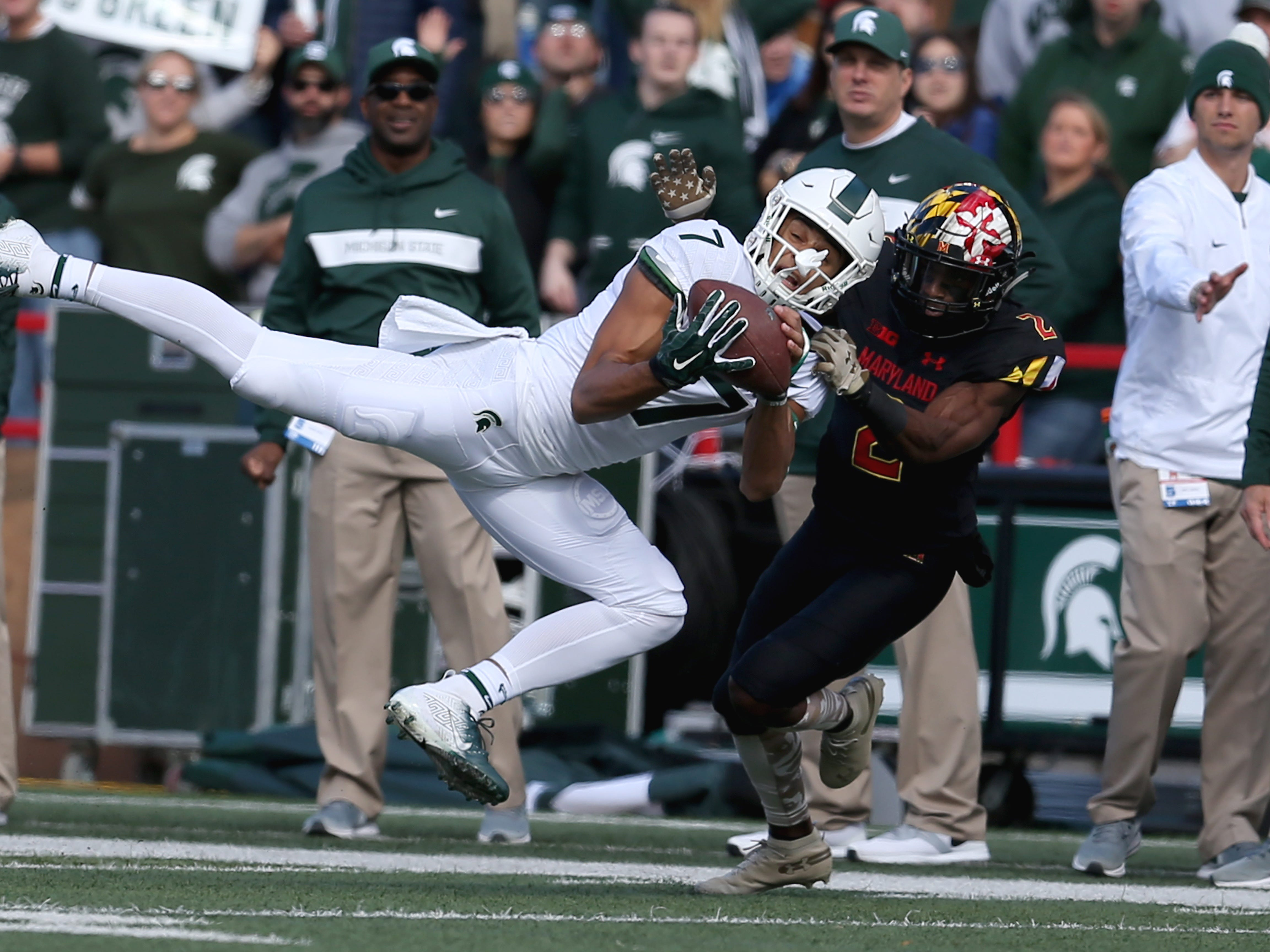 Cody White #7 of the Michigan State Spartans catches a pass against RaVon Davis #2 of the Maryland Terrapins during the first half at Capital One Field on November 3, 2018 in College Park, Maryland.
