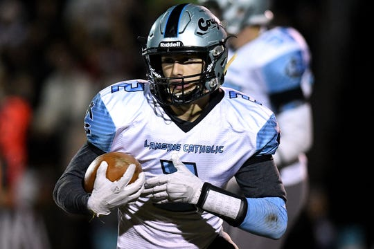 Lansing Catholic's Zach Gillespie runs with the ball during the second quarter on Friday, Nov. 2, 2018, at Portland High School.