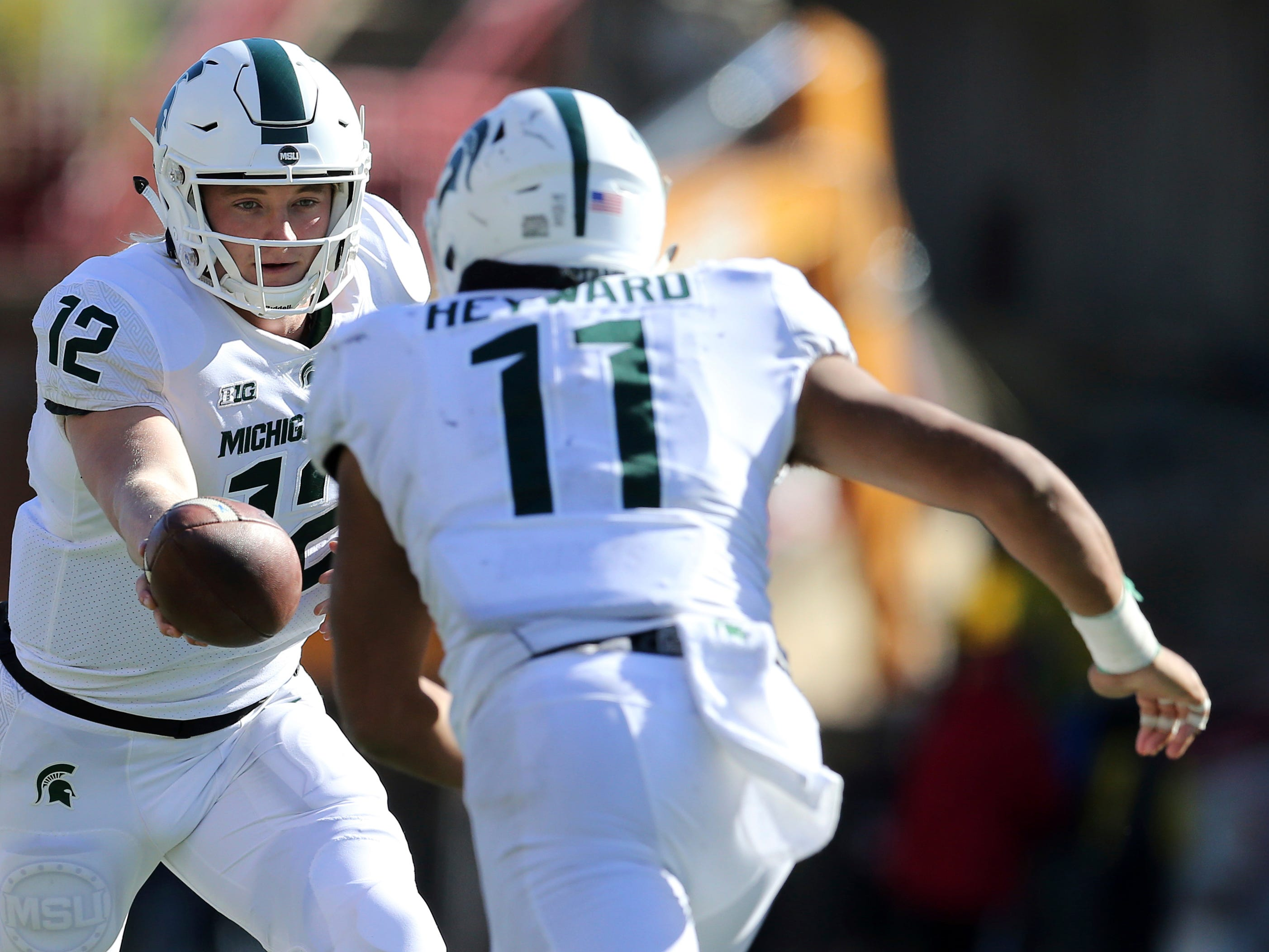 Michigan State quarterback Rocky Lombardi (12) hands off to running back Connor Heyward (11) in the second half of an NCAA college football game, Saturday, Nov. 3, 2018, in College Park, Md. Heyward scored on the play and Michigan State defeated Maryland, 24-3.