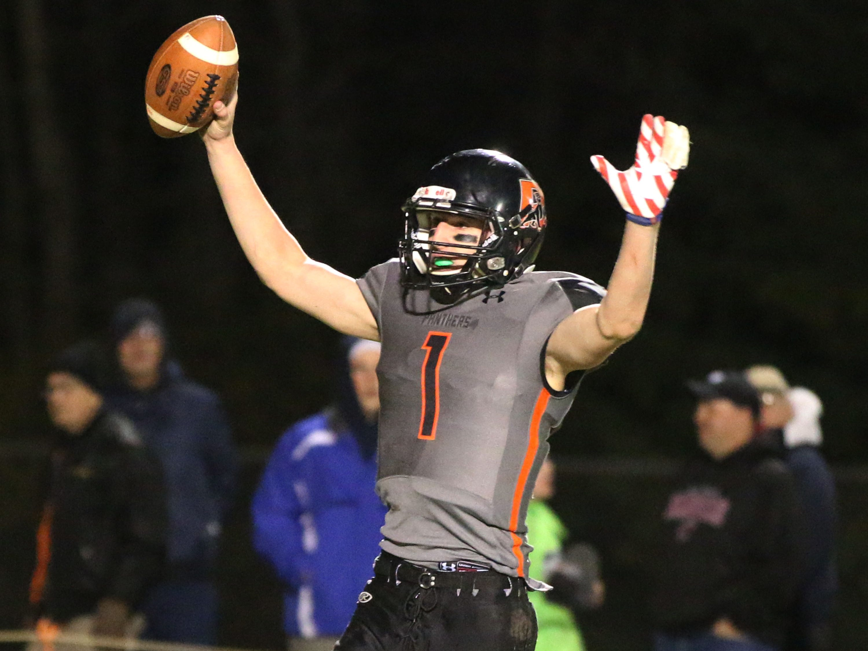 Reedsville's Carson Schanilec (1) celebrates the win over Pittsville, Friday, November 2, 2018, in Reedsville, Wis.
