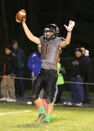 Reedsville quarterback Carson Schanilec celebrates the win over Pittsville on Friday in Reedsville.