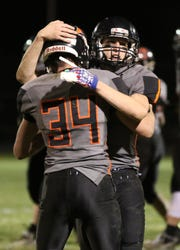 Reedsville's Brandon Steltzer (34) and Carson Schanilec (1), Friday, November 2, 2018, in Reedsville, Wis.