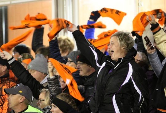 Reedsville fans cheer during player introductions before action with Pittsville, Friday, November 2, 2018, in Reedsville, Wis.