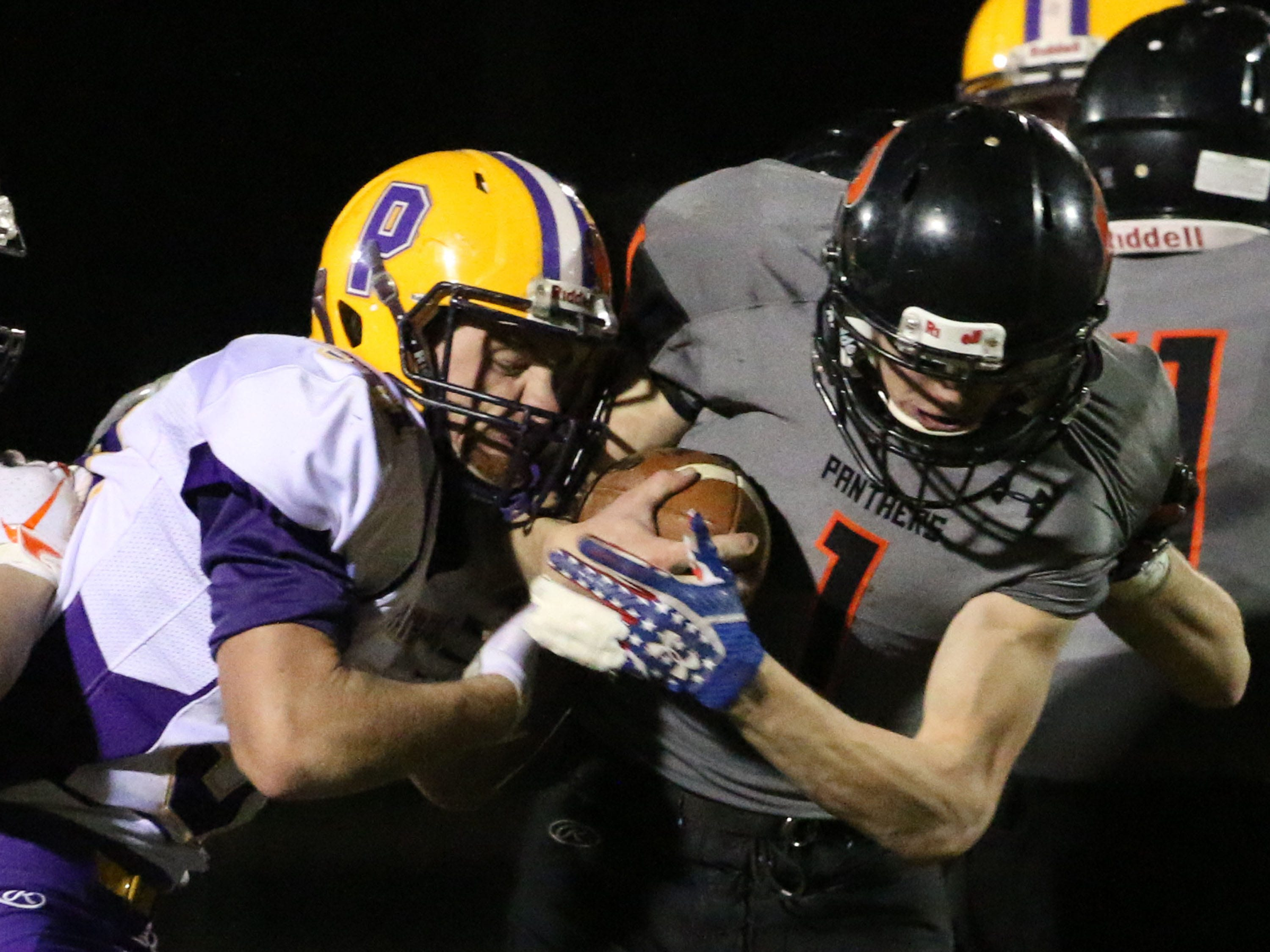 Reedsville's Carson Schanilec (1) tightly grips the ball against Pittsville, Friday, November 2, 2018, in Reedsville, Wis.