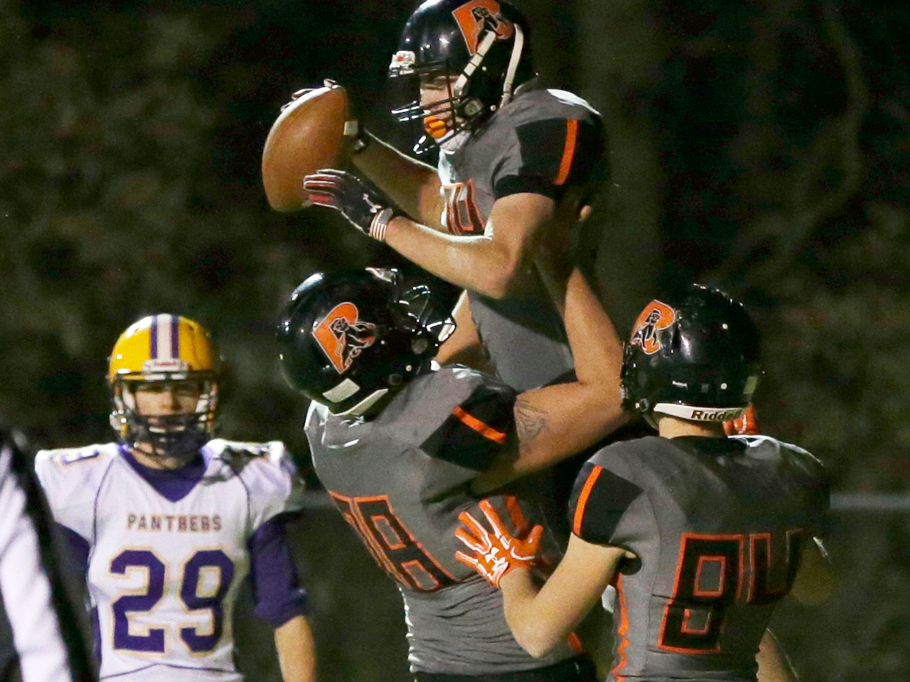 Reedsville's Brandon Stelzer (34) celebrats in the end zone after scoring a touchdown against Pittsville, Friday, November 2, 2018, in Reedsville, Wis.