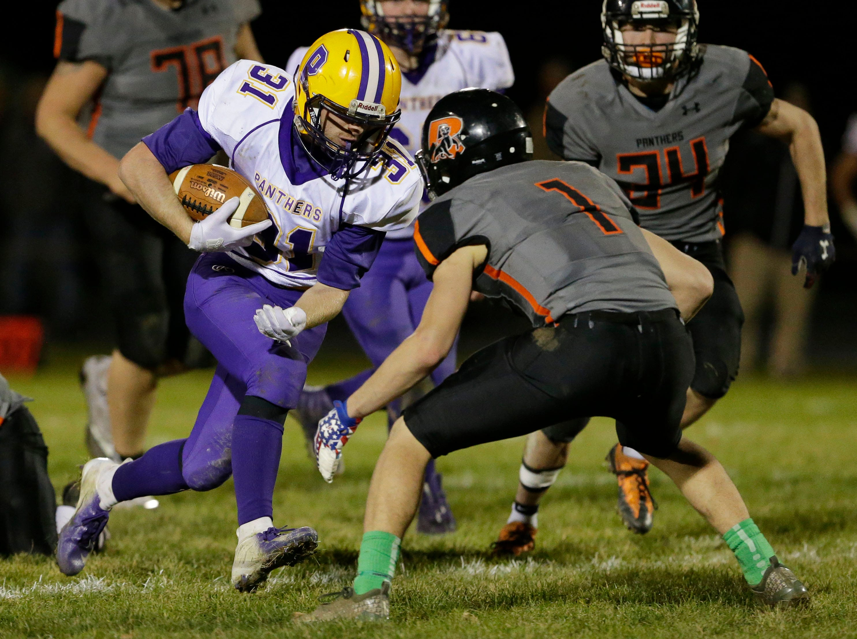 Pittsville's Trayson Ortner (31) carries the ball against Reedsville, Friday, November 2, 2018, in Reedsville, Wis.