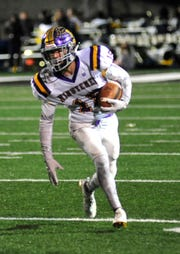 Lexington's Alex Green runs with the ball while playing at Tiffin Columbian on Friday evening.