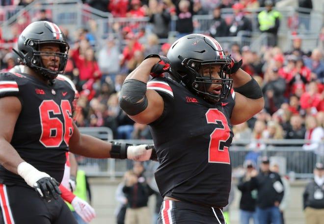 Ohio State tailback J.K. Dobbins celebrates one of his three touchdowns in Saturday's 36-31 win over Nebraska.