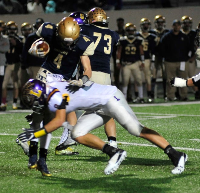 Lexingon's Cade Stover makes a tackle in this year's first round playoff win over Tiffin Columbian.