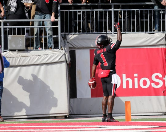Ohio State's Johnnie Dixon celebrates his first quarter touchdown.