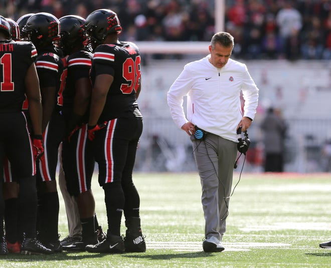Ohio State coach Urban Meyer alone with his thoughts during Saturday's game against Nebraska. There's a lot to think about these days.