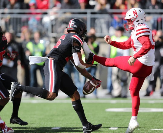 Ohio State linebacker Keandre Jones blocks a punt in the first quarter that went out of the end zone for a safety.