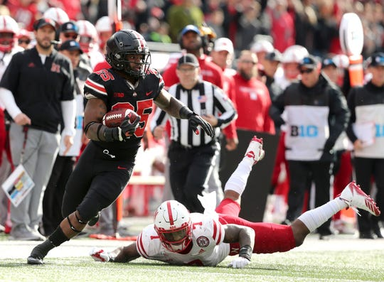 Ohio State tailback Mike Weber leaves Nebraska linebacker Mohamed Barry in his wake during Saturday's 36-31 win.